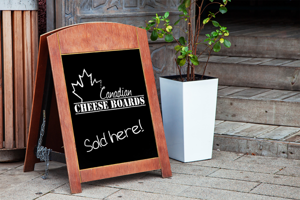 photo of sandwich board with Canadian Cheeseboards logo